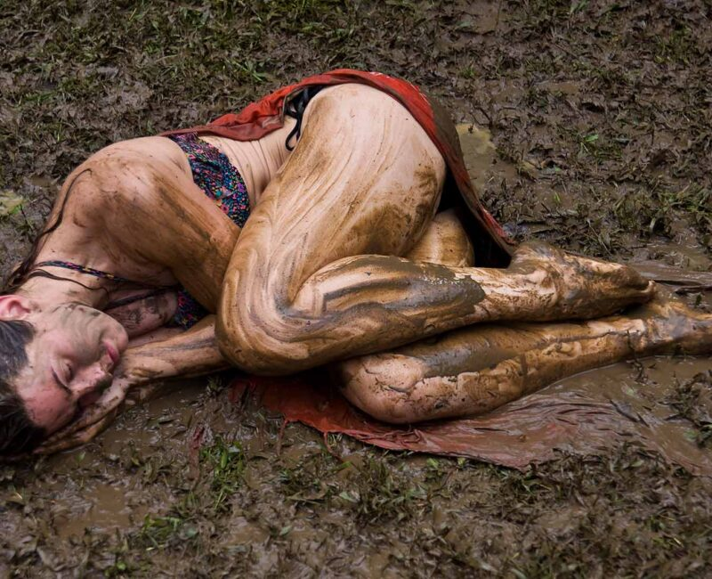Spiritual Quest - Photo of woman in laying in mud